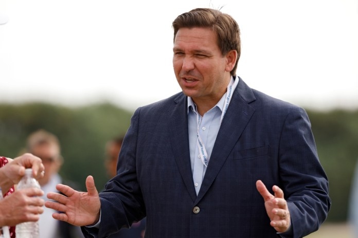 Florida governor Ron DeSantis meets with fans in Juno Beach, Fla.