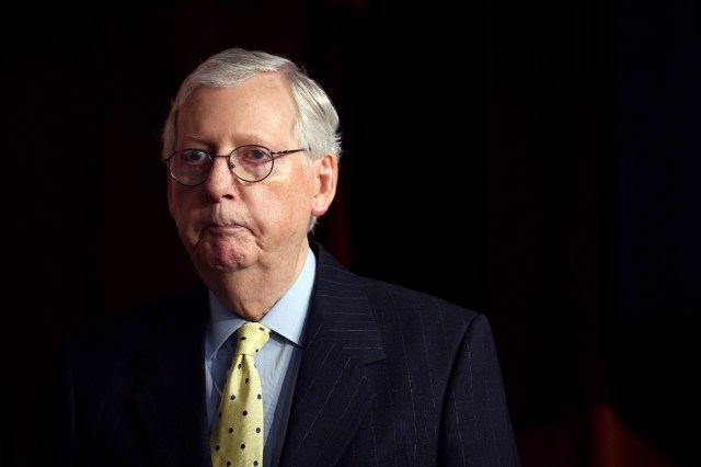 Senate Minority Leader Mitch McConnell attends a press conference.