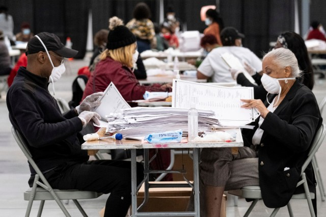 Workers sort and stack ballots in preparation for scanning during a recount in Georgia on Nov. 24.