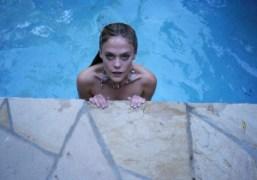 Chelsea Schuchman taking a swim at Villa Le Reve, Los Angeles