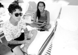 Dustin DollinandEmilie Kareh lounging by the pool of theBeverly Hills Hotel,Los Angeles.Photo…