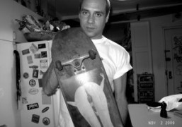 Paul Sevigny at his apartment with the first skateboard customized by Larry…