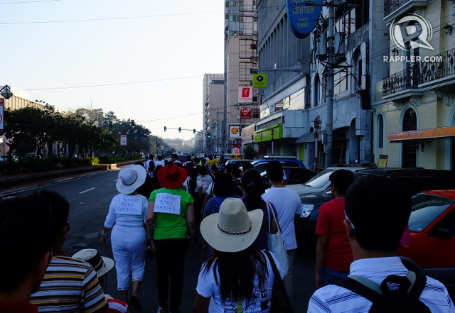 WALKING IN THE METRO. Supporters of the Share the Road movement walk through Kalaw Avenue, Manila early morning on February 17