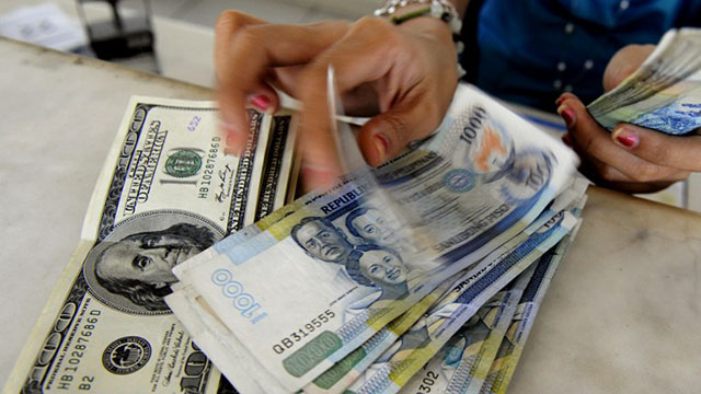EXCHANGE RATE. US dollar expected to weaken further. Photo by AFP