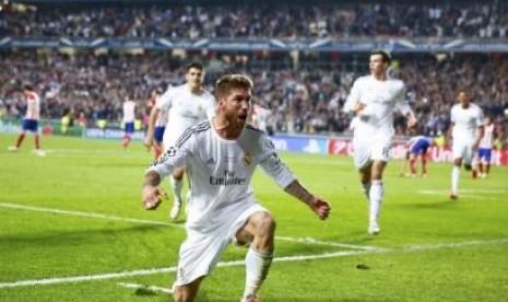 Pemain Real Madrid Sergio Ramos usai menyamakan kedudukan dengan Atletico Madrid.