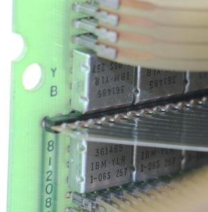 This closeup of the diode board shows the square metal SLT modules labeled 361485. Each one contains 8 diodes. The Mylar tape connections are at the top and bottom, while the