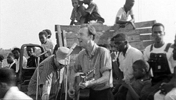 https://i2.wp.com/static.rogerebert.com/redactor_assets/pictures/scanners/hes-here-the-legend-of-pete-seeger/psnscc.jpg
