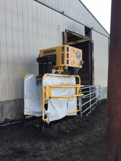 The fly vac on the Burkholder's family farm is placed between the barn and the pasture.