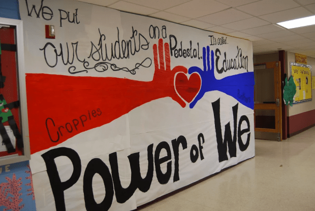 A mural in the school hallway that says Power of We. We put our students on a pedestal. It's called education.