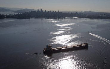 Spill response boats work to contain fuel leaking from the bulk carrier cargo ship Marathassa, anchored on Burrard Inlet, Thursday, April 9, 2015, in Vancouver, British Columbia. The City of Vancouver warned that the fuel is toxic and should not be touched. (AP Photo/The Canadian Press, Darryl Dyck)