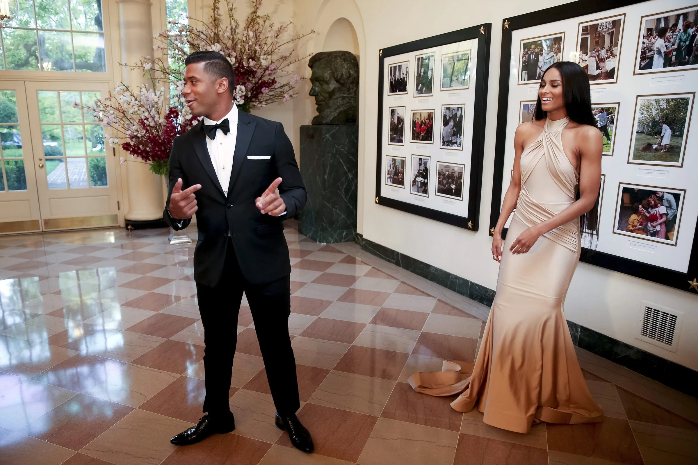 Seattle Seahawks Quarterback Russell Wilson and entertainer Ciara Harris arrive for a state dinner for Japanese Prime Minister Shinzo Abe, Tuesday, April 28, 2015, at the White House in Washington.  (Andrew Harnik / The Associated Press)