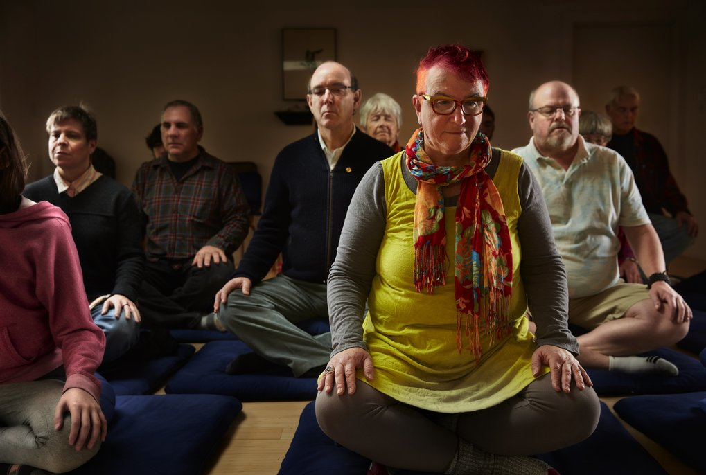 Sue Lesser, front right, joins others in a Sunday morning open meditation at the Shambhala Meditation Center in Madison Valley. (Benjamin Benschneider/The Seattle Times)