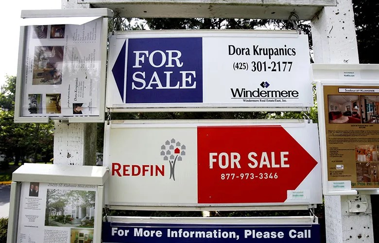HOME SALES IN SEATTLE AREA080608   These signs in Issaquah point the way to home sales.