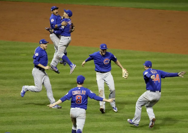 The Chicago Cubs celebrate after Game 7 of the Major League Baseball World Series against the Cleveland Indians Thursday, Nov.
