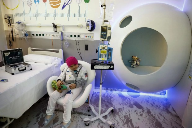 A girl suffering from cancer poses in a isolated room recreating a space station during its inauguration at the Gregorio Maranon Hospital's children oncology unity in Madrid, Spain, November 2, 2016.