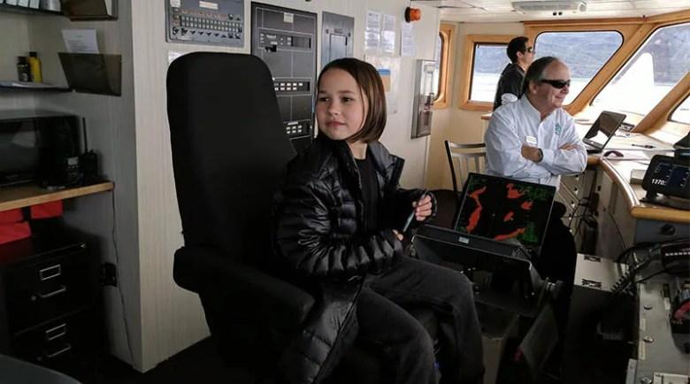 Erysse Elliott on the bridge of the Chichagof Dream in Alaska's Inside Passage. (Christopher Elliott)