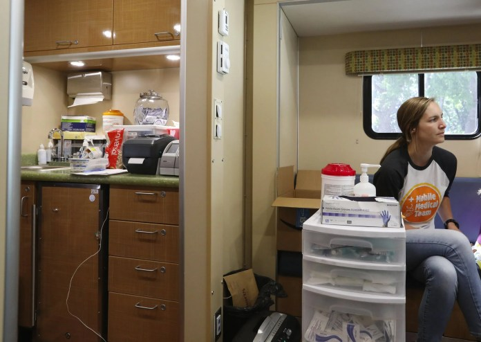 """Julie Little, a registered nurse, has worked in this King County public health mobile RV since December, in a program that's currently used to treat wounds and prescribe medication-assisted treatment, Thursday, Aug. 1, 2019 in Seattle. Later in the year, Little will be part of a three-person """"street medicine"""" team, in a new program intended to augment the mobile RV program. """"I'm super excited,"""" said Little. """"The work is similar but we'll be able to access populations difficult to reach."""" 211053 (Ken Lambert / The Seattle Times)"""