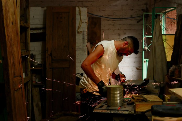 Rafael works in his carpentry shop. (Erika Schultz / The Seattle Times)