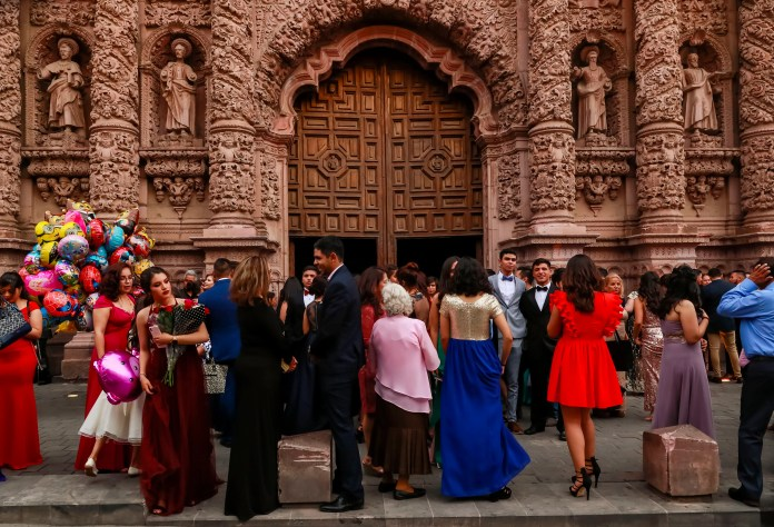 Families stream out of a graduation celebration at the Catedral Basílica de Zacatecas. (Erika Schultz / The Seattle Times)