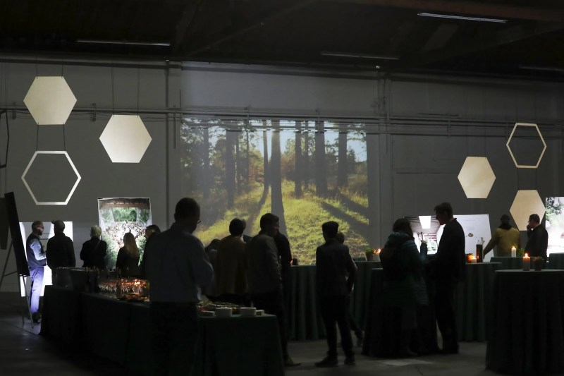 Nature scenes are projected on the wall at the Recompose official launch event last week at the company's newly found space for its funeral home, in Seattle's Sodo area. The planned opening is spring 2021. (Ken Lambert / The Seattle Times)