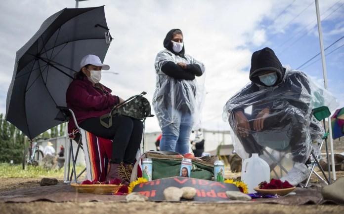 Allan Bros. employees Maribel Medina, left, and Cesar Traverso, right, began a hunger strike May 19 at the Allan plant in Naches. Some other Allan workers have been on strike since May 7 because of safety concerns related to the novel coronavirus pandemic.  (Evan Abell / Yakima Herald-Republic)