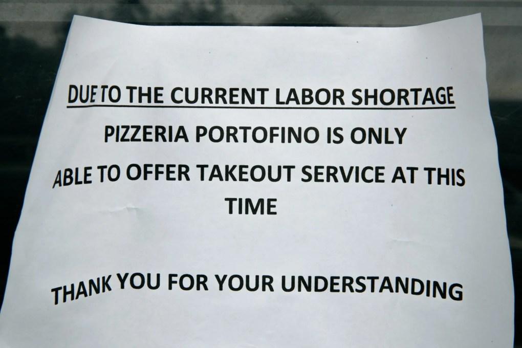 A sign at Pizzeria Portofino, in Eastsound, Orcas Island, on Thursday.  (Erika Schultz / The Seattle Times)