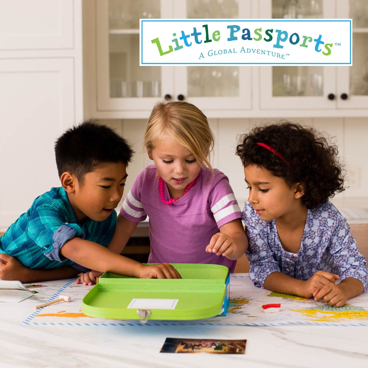 Three kids playing with little passports