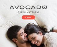 couple laying on a natural green mattress