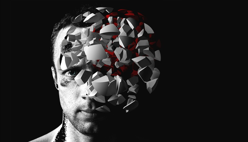 Caucasian man creative portrait with 3d explosion fragments on black background