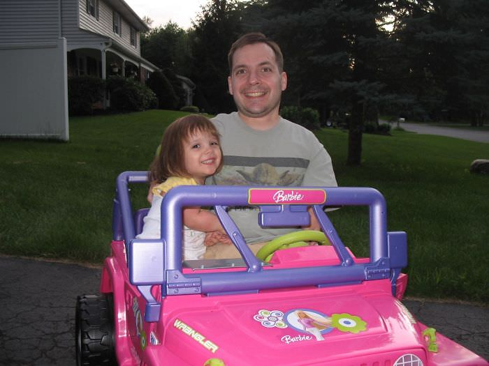 One Benefit Of Being A Little Person Is That You Can Drive Your Daughter Around In Her Barbie Jeep When She