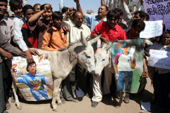 Indian cricket supporters parade a pair