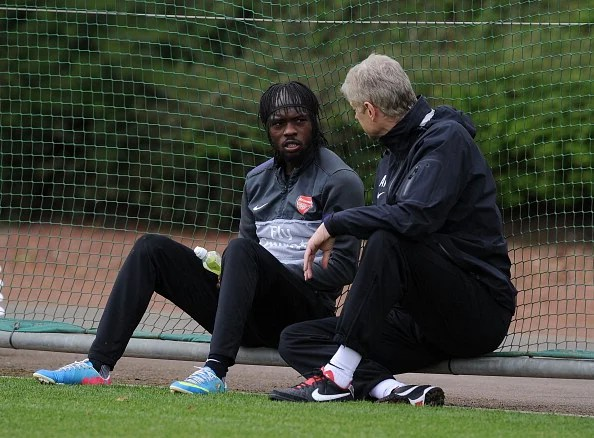 Arsenal manager Arsene Wenger talks to Gervinho after a training session at London Colney on May 13, 2013 in St Albans, England.  (Getty Images)