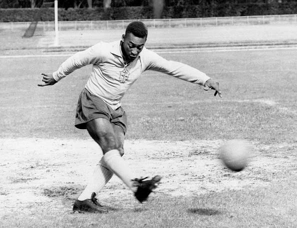 The famous Brazilian football legend Pele playing football. Circa 1950+s.