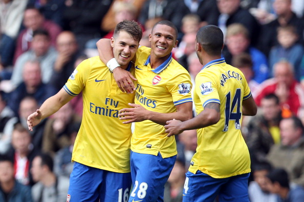 Aaron Ramsey (L) celebrates scoring his second and his team's third goal with  Kieran Gibbs (C) and Theo Walcott (R) against Sunderland