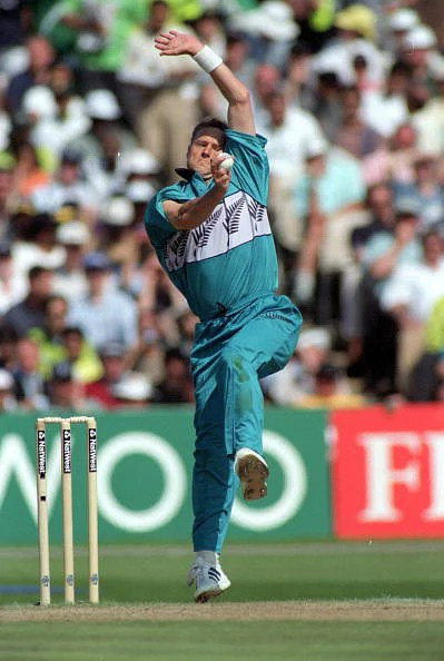 Gavin Larsen bowls during the 1999 World Cup semi-final against Pakistan - his last game before retiring.  (Getty Images)