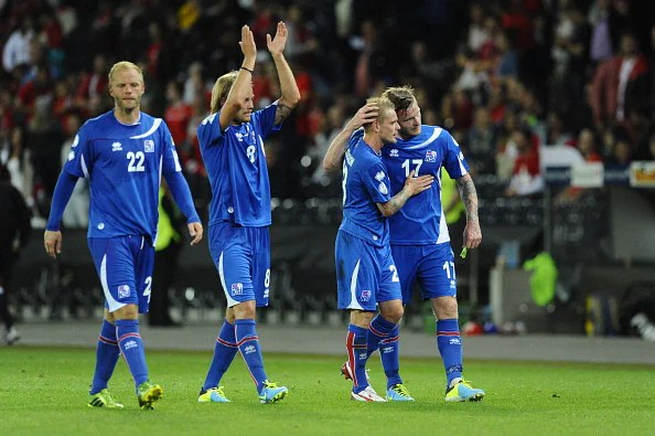 Iceland players celebrate at the end of their FIFA World Cup 2014 qualifier vs. Switzerland at the Stade de Suisse on September 6, 2013, in Bern. (Getty Images)