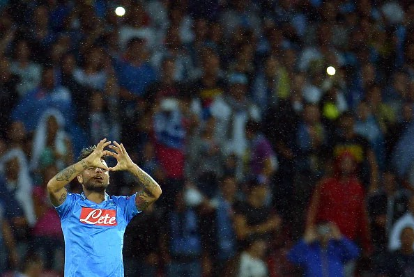Napoli's forward Lorenzo Insigne celebrates after scoring during the group F Champions League football match SSC Napoli vs Borussia Dortmund