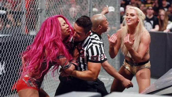 Sasha battles back after being put through the announce table