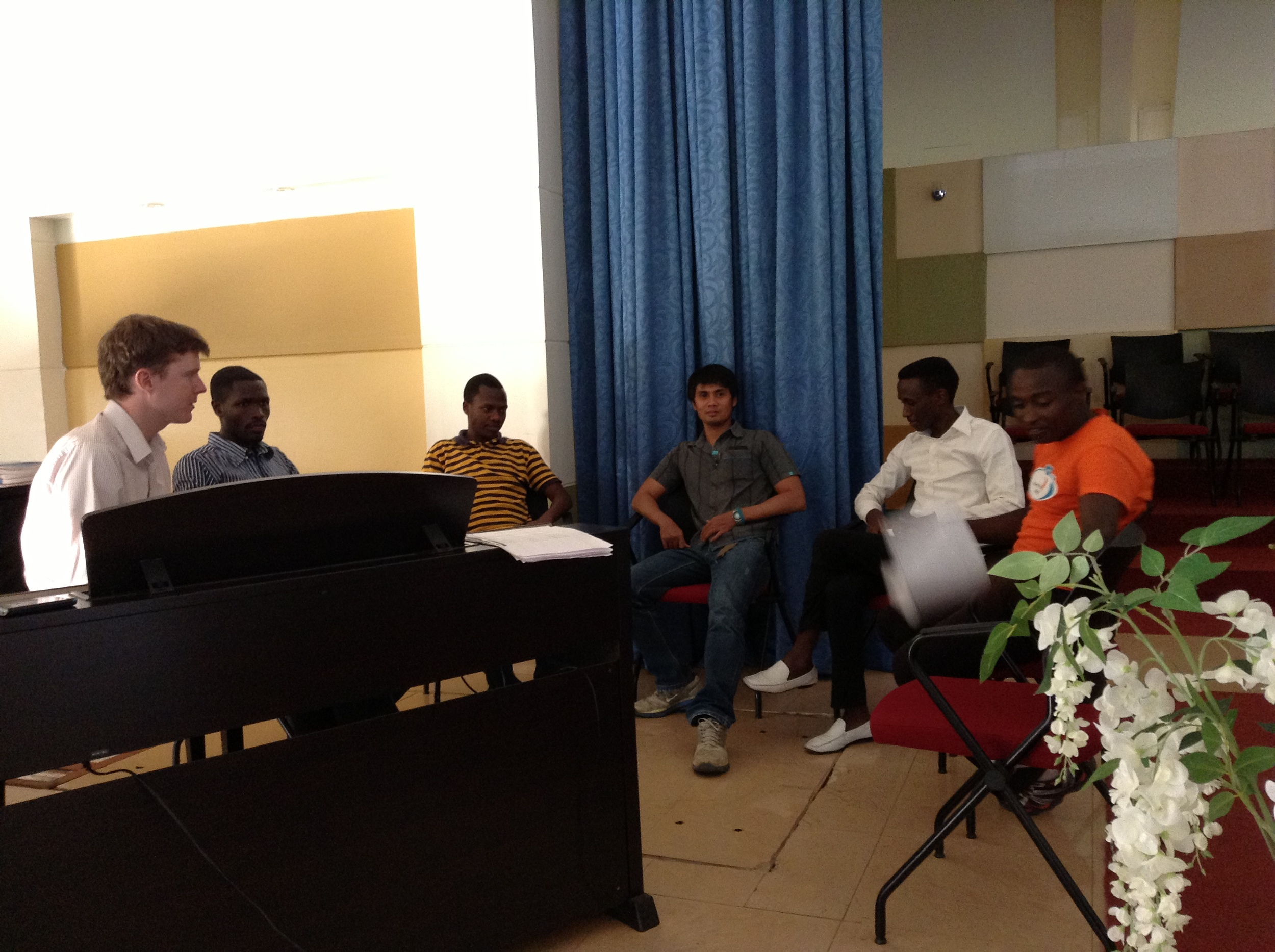 We also have our voice ensemble. There are seven of us, all guys; Danny, myself, and five AUCA students. Along with Danny (the Filipino looking guy in this pic), we are really working on harnessing the power of their voices to create a strong, pure, and harmonious sound. When you combine the power of an African voice with proper technique and pitch, there is nothing else like it.