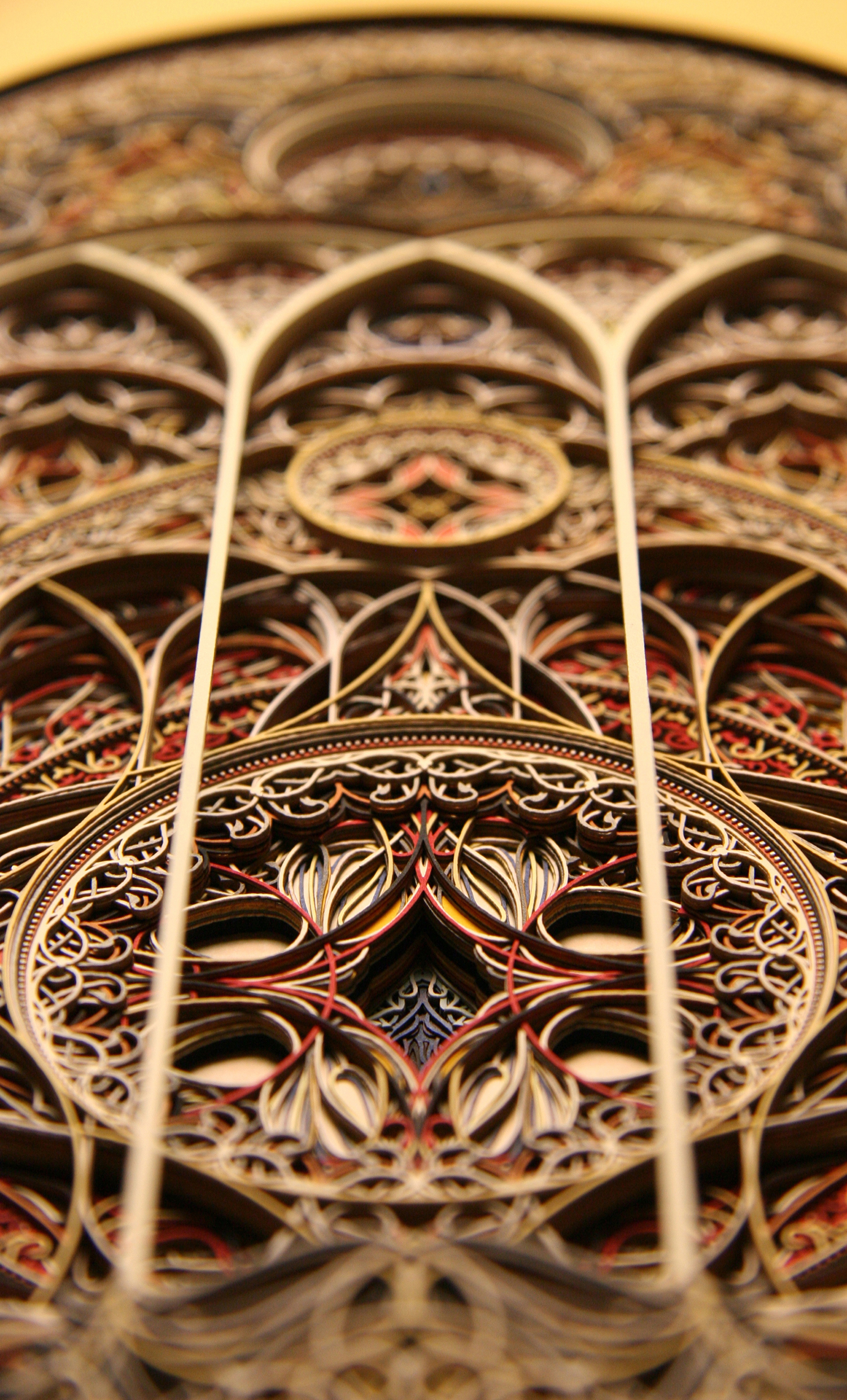 Ornate window-style art made with cut paper