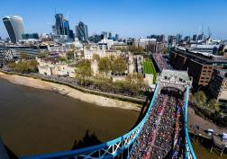 Runners make their way over Tower Bridge as temperatures at the 2018 London Marathon hit record heights