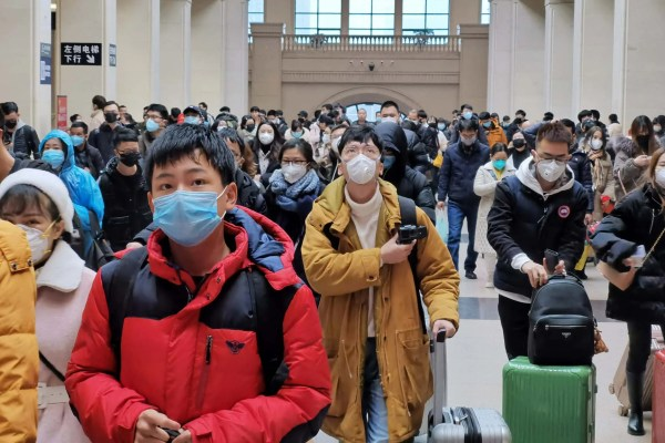 Moment chant of solidarity echoes across Wuhan in defiance of coronavirus
