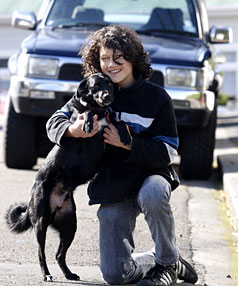 EAT TUI? YEAH, RIGHT: 12-year-old Eli Mulheron with his dog Tui.