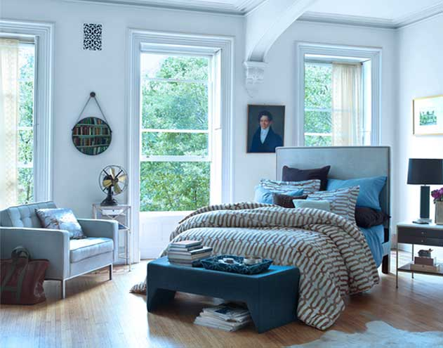 bedroom with poster bed and many Nate Berkus pillows and throws