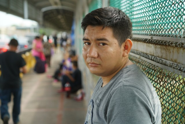 Marcos Samayoa, who traveled from Guatemala to the U.S-Mexico border, waits on the international bridge to seek asylum in the United States