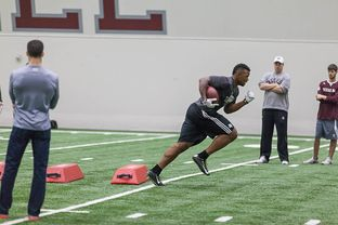 Texas A&M football team runs drills during the spring practice on March 3, 2015.