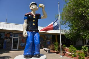 """A statue of Popeye the Sailor stands at the front of the Crystal City City Hall. The struggling South Texas town calls itself the """"Spinach capital of the world."""""""