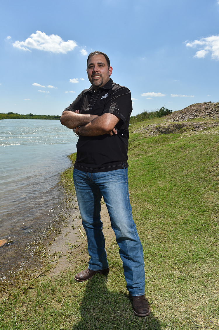 Salvador Salinas in his 500-acre property in Maverick County. The private property ends where the banks of the Rio Grande begin.