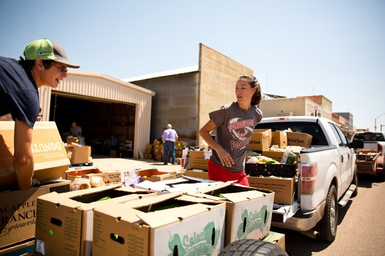 Sage Cabellero loads a family box onto a trailer for delivery to Silverton, Texas, a neighboring community in the Tri-County Meals network.