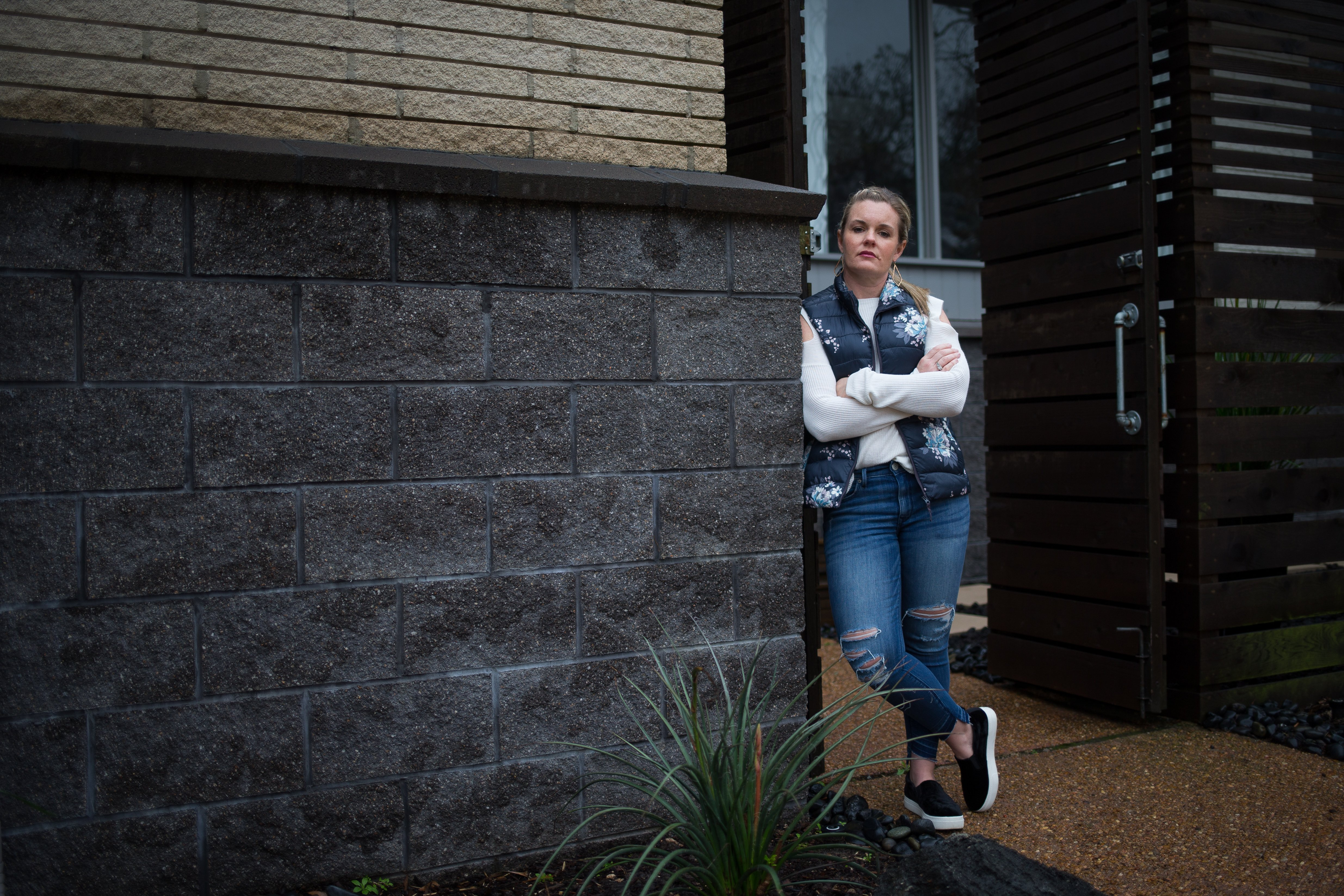 Erin Anders stands in front of her family's home in Houston's Meyerland neighborhood on Feb. 13, 2018. Anders and her husband, Doug Anders, elevated their home in 2017 prior to Hurricane Harvey, saving it from potentially catastrophic damage. The couple and their two children evacuated using inflated pool floats as the floodwaters rose around their home.